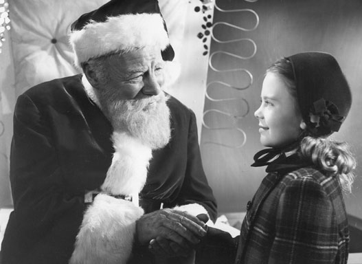 Edmund Gwenn as Kris Kringle and Natalie Wood as Susan Walker